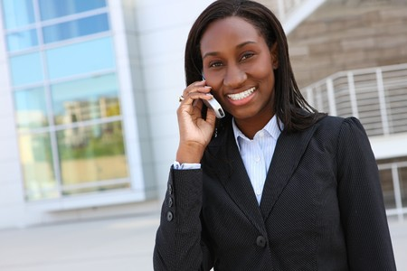 Pretty african business woman on mobile phone at office building Stock Photo - 7011042
