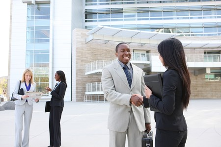 A diverse business man and woman team handshake at office building Stock Photo - 7011036