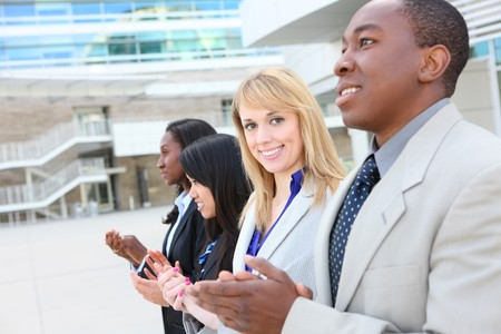 A diverse attractive man and woman business team at office building Stock Photo - 7011047