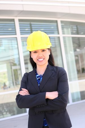 asian architect: A pretty young asian construction woman on building site