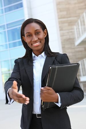 A pretty african american business woman offering a handshake Stock Photo - 7011045