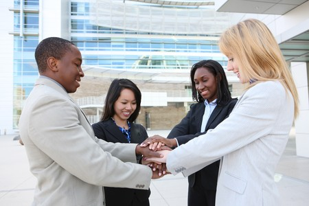 A diverse business man and woman team celebrating success at office building photo
