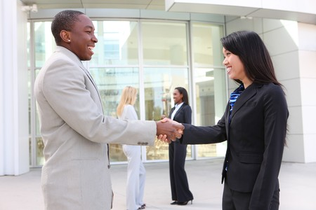A diverse business man and woman team handshake at office building Stock Photo - 7011059