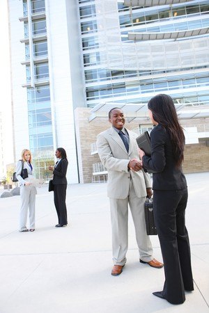 A diverse business man and woman team handshake at office building Stock Photo - 7011065