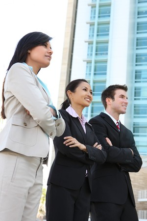 corporate group: A diverse attractive man and woman business team at office building