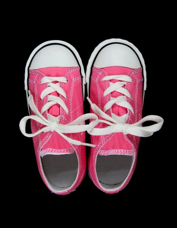 athletic wear: Pink Girls Sneakers (Tennis Shoes) over a black background Stock Photo