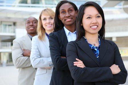 A diverse attractive man and woman business team at office building Stock Photo - 7049685
