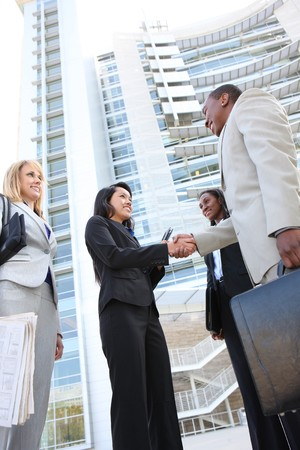 A diverse business man and woman team handshake at office building Stock Photo - 7049690