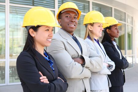 architect: An attractive diverse man and woman architect team on construction site  Stock Photo