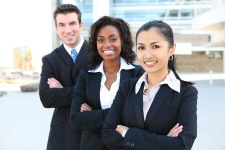 african business people: A diverse attractive man and woman business team at office building
