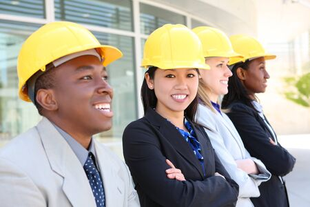 skills diversity: An attractive diverse man and woman architect team on construction site  Stock Photo