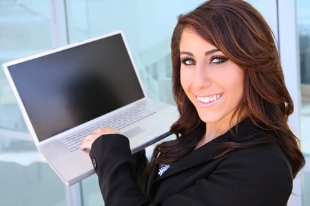 Woman at business office using her laptop computer  Stock Photo - 7118296