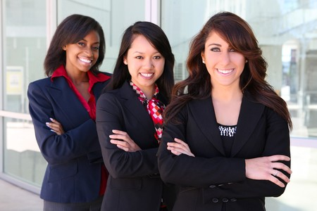 A pretty diverse young business woman team at office building Foto de archivo