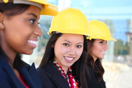 An attractive diverse woman architect team on construction site Stock Photo - 7118307
