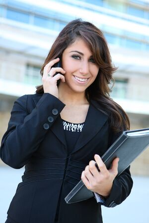 Beautiful business woman on the phone at modern office building  Stock Photo - 7118306