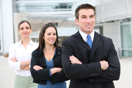 An attractive business man and woman team at office building photo