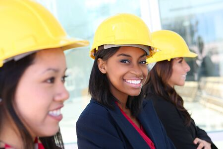 aucasian: An attractive diverse woman architect team on construction site