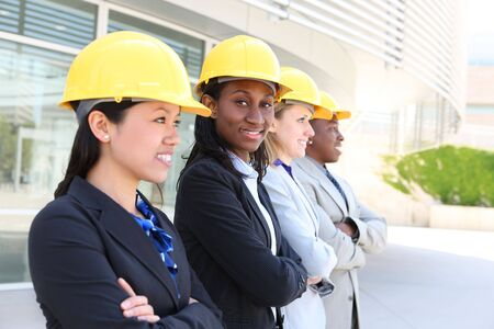 asian architect: An attractive diverse man and woman architect team on construction site  Stock Photo
