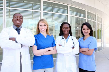 A diverse attractive man and woman medical team at hospital building photo