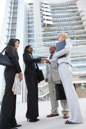 A diverse business man and woman team handshake at office building Stock Photo - 7213619