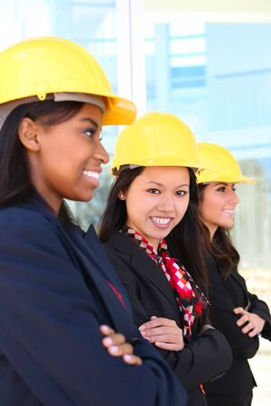 �aucasian: An attractive diverse woman architect team on construction site