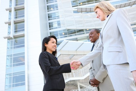 Man and Woman young and  diverse business team handshake at office building photo