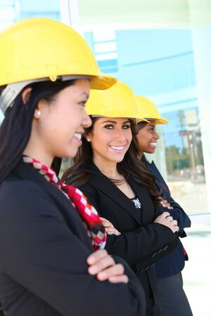 An attractive diverse woman architect team on construction site  photo