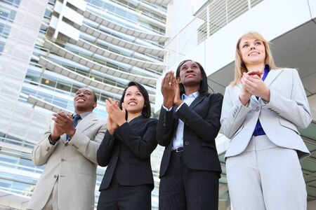 An diverse business man and woman team clapping at office building