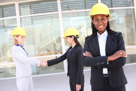 site: An attractive diverse man and woman architect team on construction site  Stock Photo
