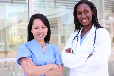 practitioner: Attractive, diverse medical woman team at hospital  Stock Photo