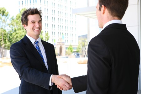 negotiate: A business man team at office shaking hands  Stock Photo