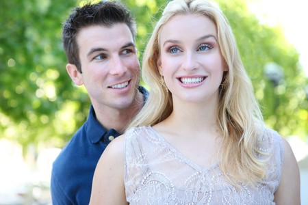 A pretty blonde woman and handsome man in love in the park Stock Photo - 7389574