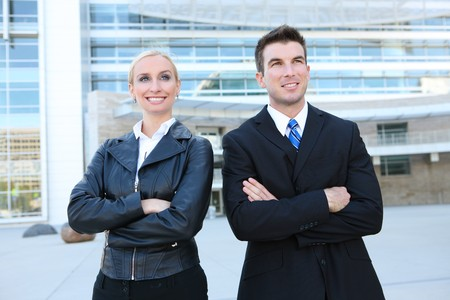 A young attractive business man and woman team at office building photo