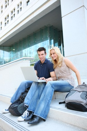 A man and woman student at school studying at college  photo