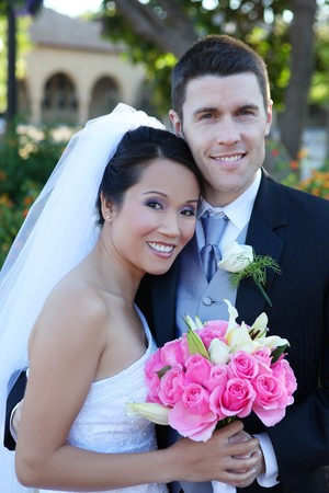 asian bride: A beautiful bride and handsome groom at church during wedding Stock Photo