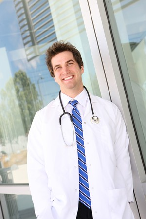 A young handsome man doctor outside hospital building Stock Photo - 7580218