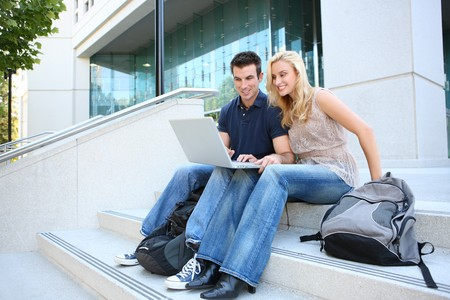 teens school: A man and woman student at school studying at college