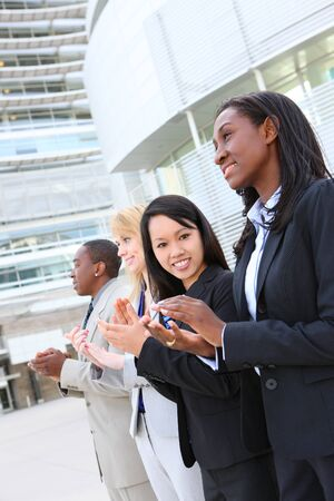 A diverse attractive man and woman business team at office building Stock Photo - 7618454