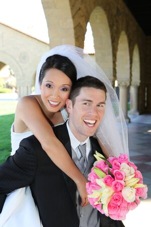 A beautiful bride and handsome groom at church during wedding Stock Photo