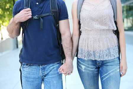 Man and woman students at school holding hands in love photo