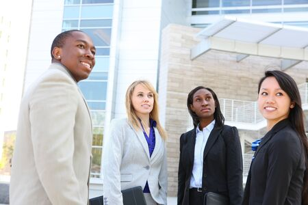An attractive business man and woman team at office building diversity Stock Photo