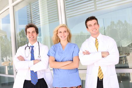 Smiling medical doctor and nurse with stethoscope at the hospital