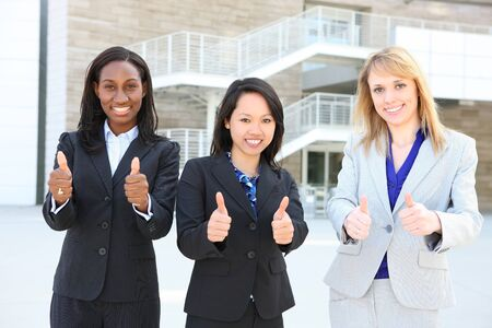 An attractive diverse business woman team at office building diversity photo