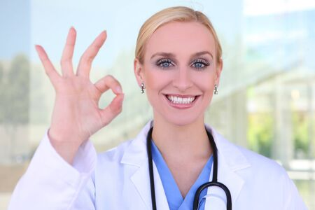 A young pretty blonde woman nurse at hospital with stethoscope photo