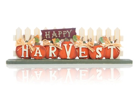 A happy harvest Thanksgiving sign over white background Stock Photo