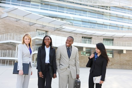 An attractive business man and woman team at office building diversity photo