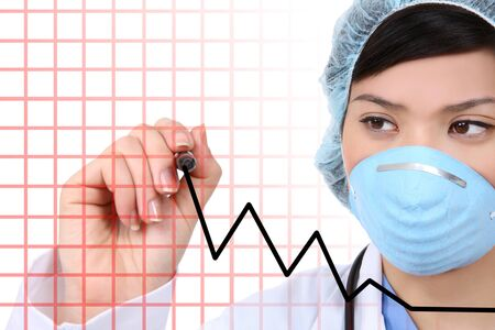 A young asian woman surgeon at hospital writing Stock Photo - 7983746