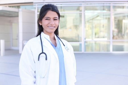 asian doctor: An Indian medical woman nurse outside hospital