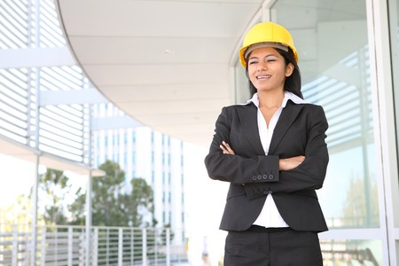 asian architect: A pretty woman architect on the building construction site