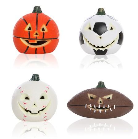 Basketball, Football, Baseball and Soccer ball sports Halloween pumpkins Stock Photo